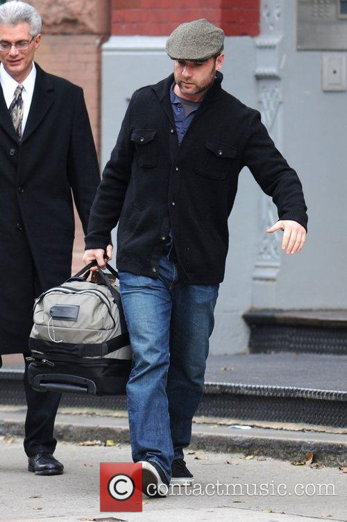 Liev Schreiber leaving his Manhattan residence carrying a...