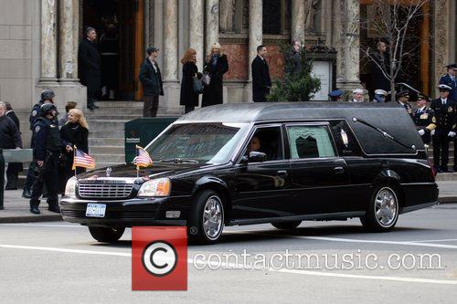 A funeral scene being filmed on location for...