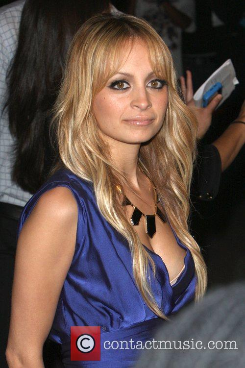 Nicole Richie and Joel Madden switch on the...