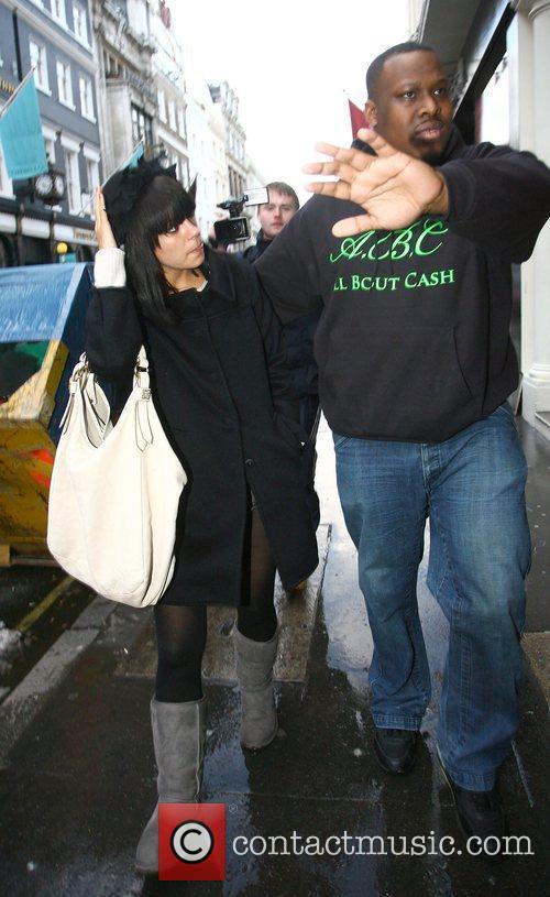 Lily Allen out in central London with a...