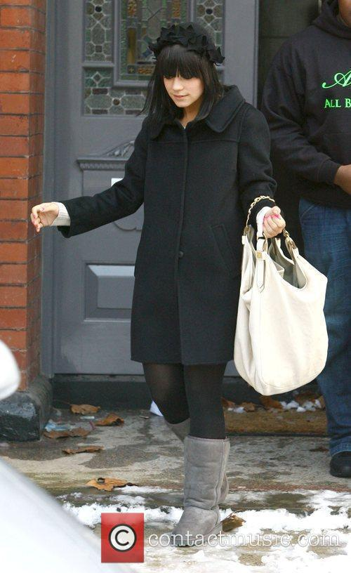 Lily Allen leaves her home with a large...