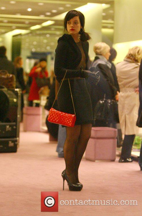 Lily Allen Christmas shopping at a Prada store...