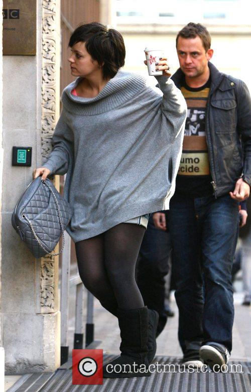 Lily Allen outside the Radio 1 studios, clutching...