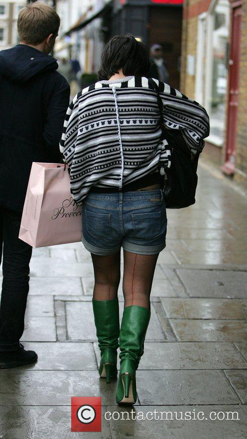 Lily Allen seen out shopping with a male...