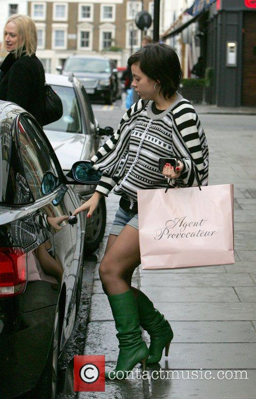 Lily Allen gets into a car wearing green...