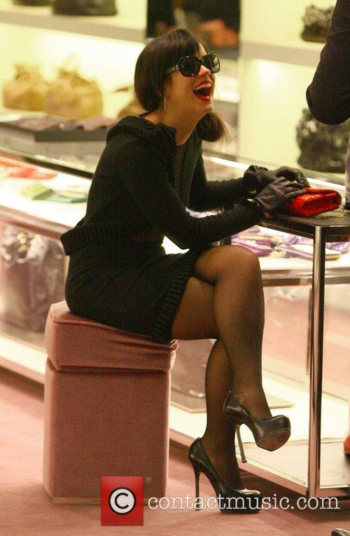Lily Allen laughs while Christmas shopping at a...