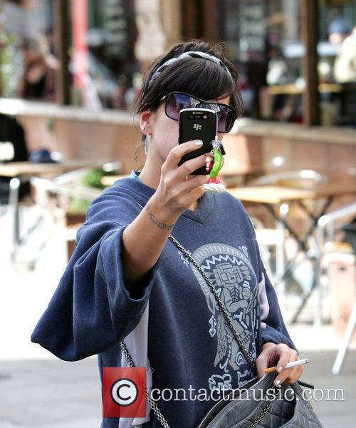 Lily Allen take pictures on her mobile phone...