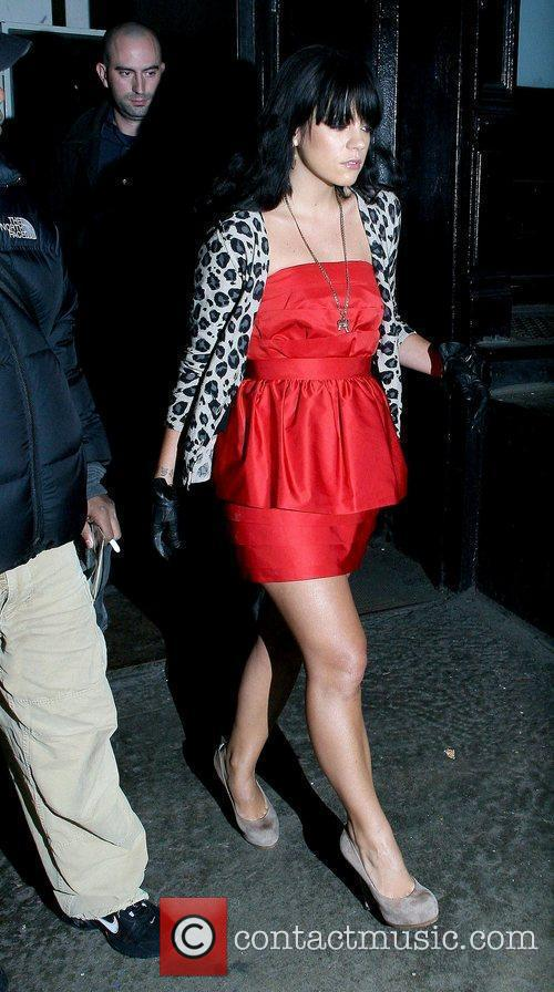 Leaving her Manhattan hotel while wearing a red...