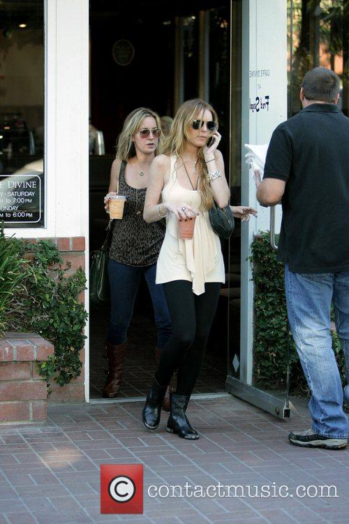 Lindsay Lohan  exits Fred Segal boutique in...