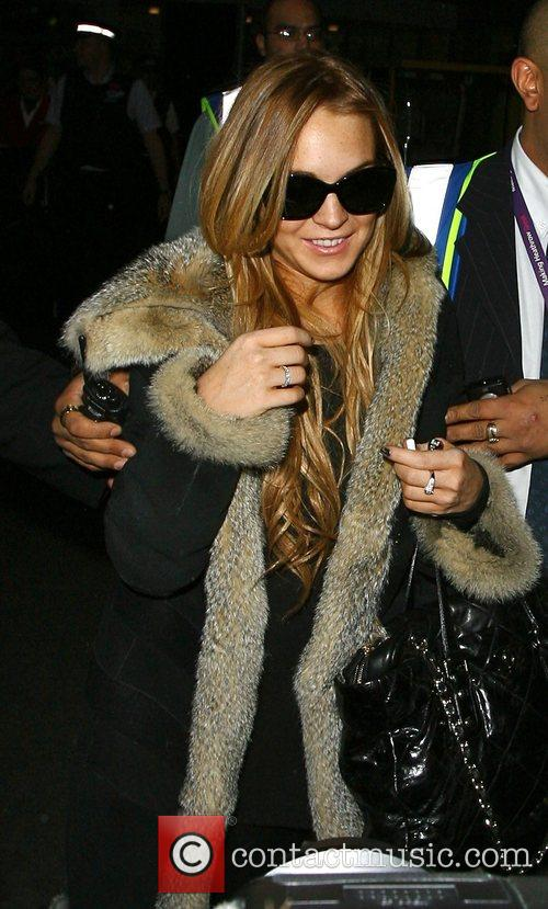 *file photos* * FUR-LOVER LOHAN ATTACKED BY FLOUR...