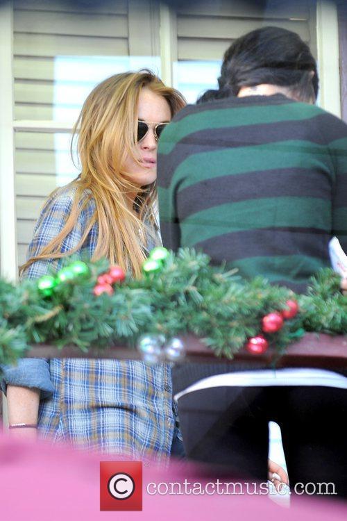 Lindsay Lohan smoking a cigarette with a friend...