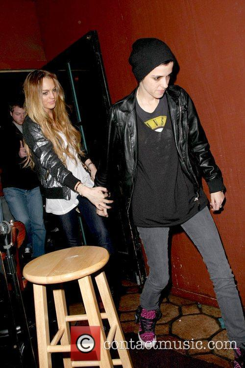 Lindsay Lohan and Samantha Ronson holding hands while...