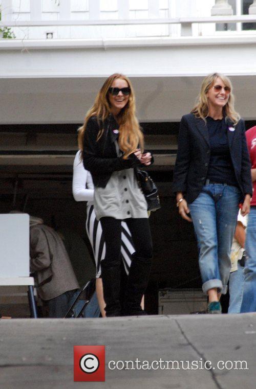 Lindsay Lohan departs a polling station after voting...