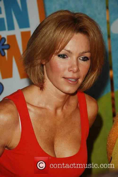 Former glamour model Nell McAndrew poses with Little...