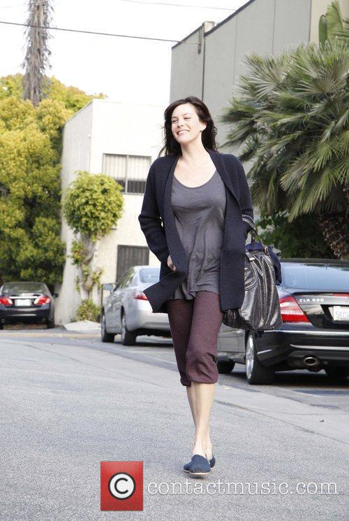A healthy and happy looking Liv Tyler leaving...