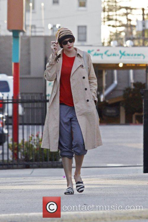 Seen leaving a health spa wearing a trench...