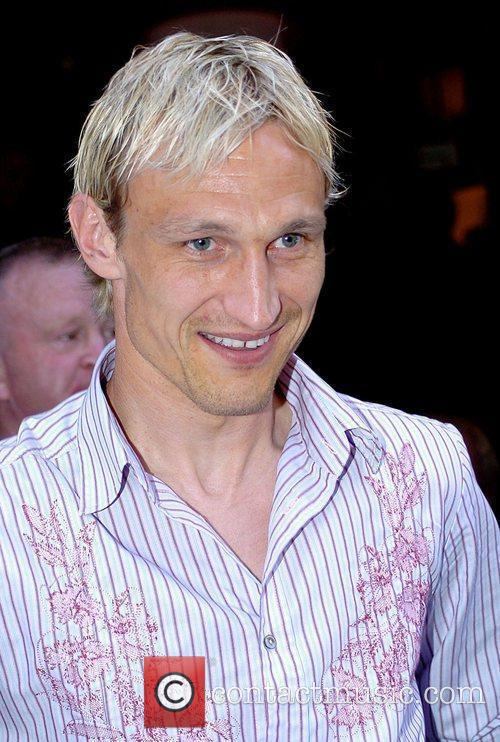 Sami Hyypia leaving Jamie Carragher's Cafe Sports bar...