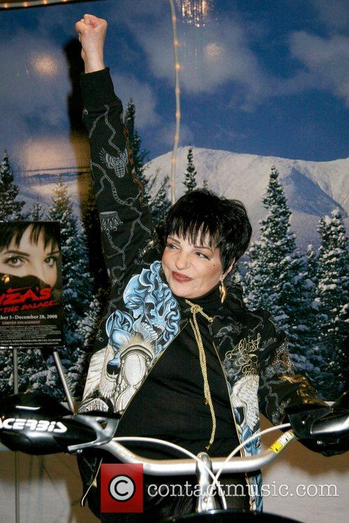 Liza Minnelli and Castmates pedals a Snowmobike at...