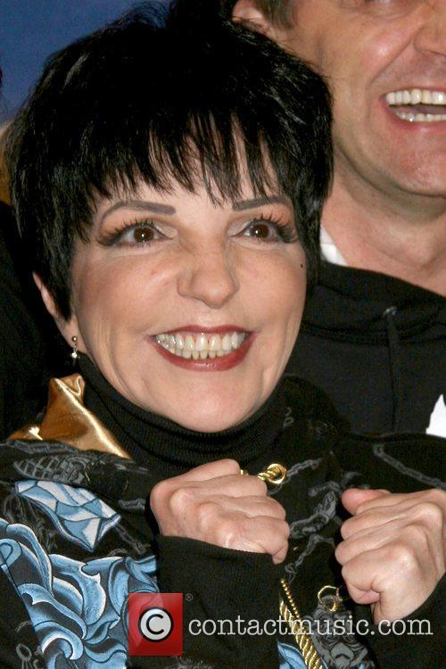 Liza Minnelli pedals a Snowmobike at 'Liza's at...