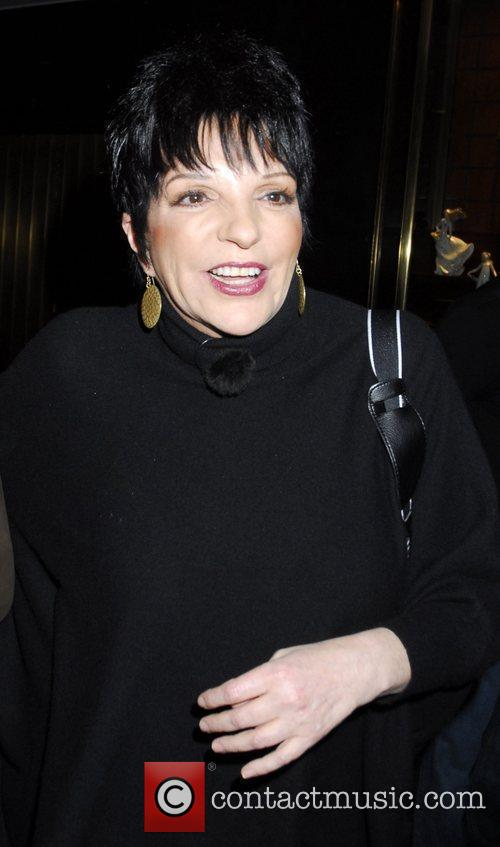 Liza Minnelli with a male companion arriving at...