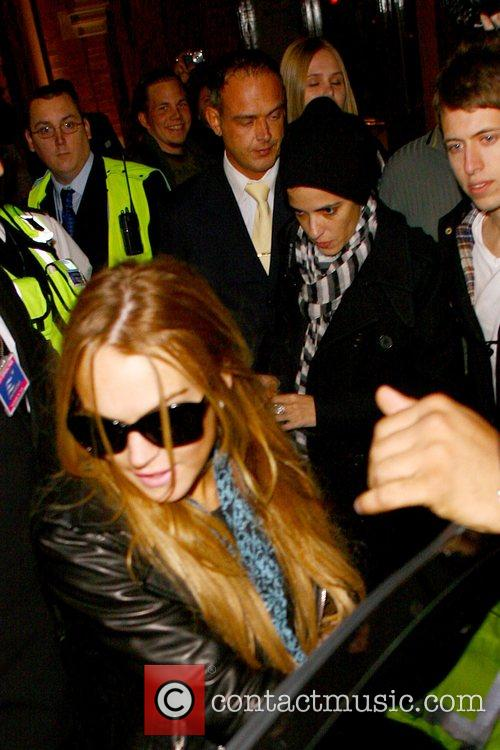 Lindsay Lohan and Samantha Ronson are escorted by...