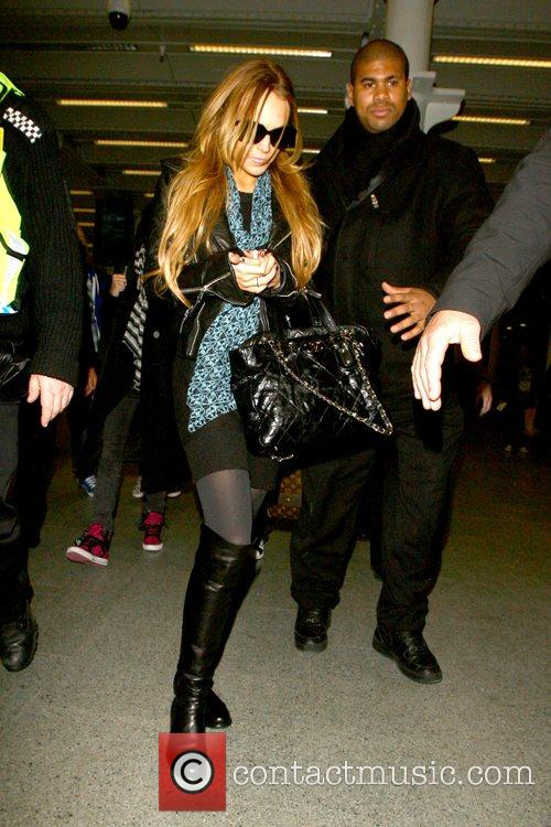 Lindsay Lohan  escorted by police upon returning...