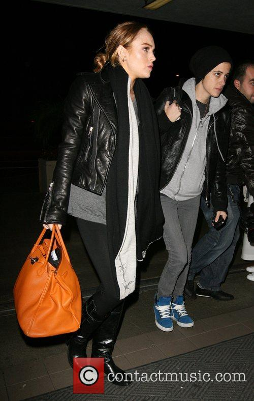 Lindsay Lohan and Samantha Ronson head to LAX...
