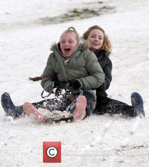 Revellers takes advantage of the snow yet to...