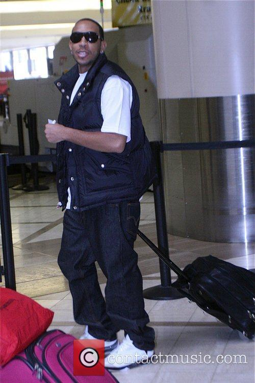 Spotted checking in for his flight at LAX...