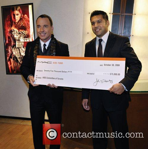 David Furnish, Karim Karsan A cheque for $75,000...