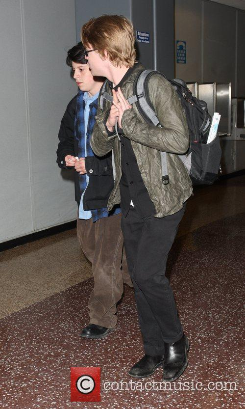 Macaulay Culkin and A Male Friend 8