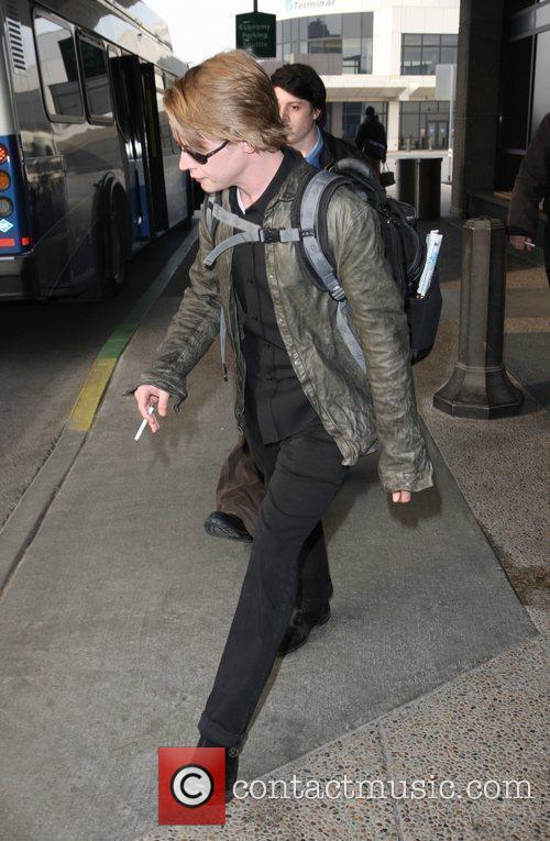 Macaulay Culkin, a male friend, Sundance Film Festival