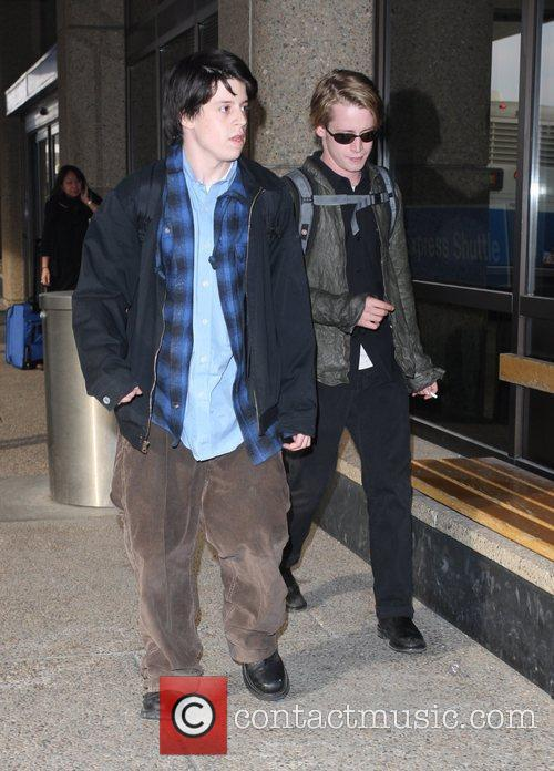 Macaulay Culkin and a male friend 8