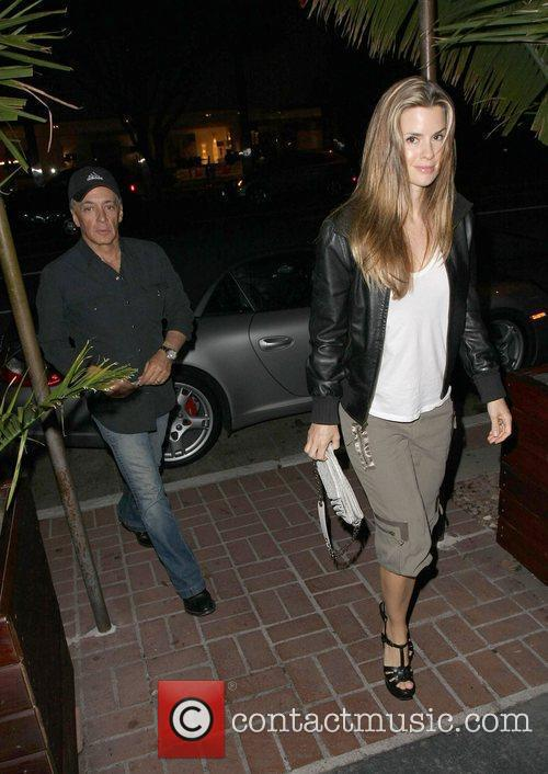 Mark Kaplan arriving at Madeo restaurant with a...