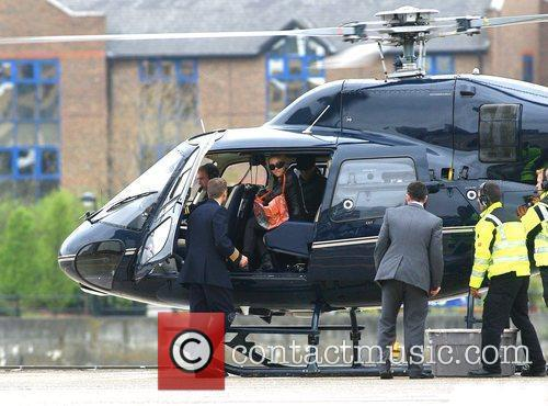 Madonna takes a helicopter ride from Battersea, carrying...
