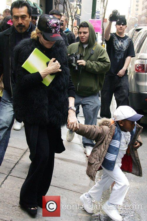 Madonna with her adopted son, David Banda, out...