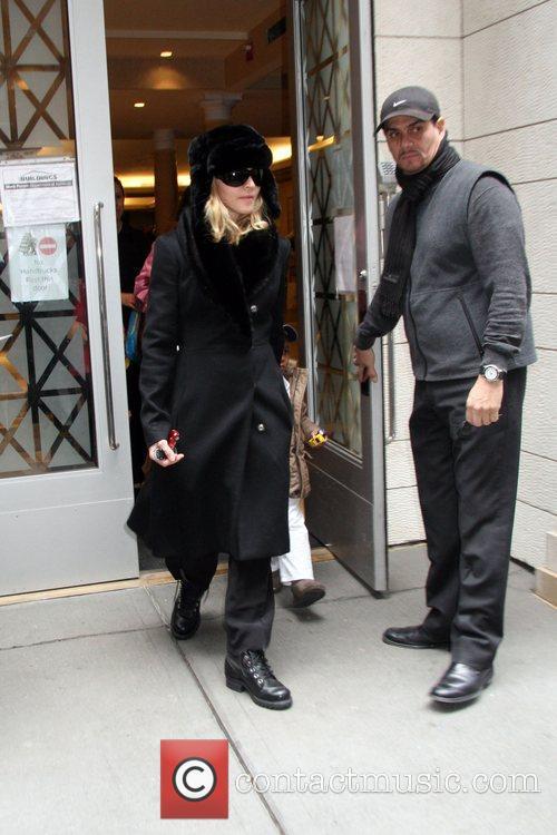 Madonna and baby David seen leaving the Kabbalah...