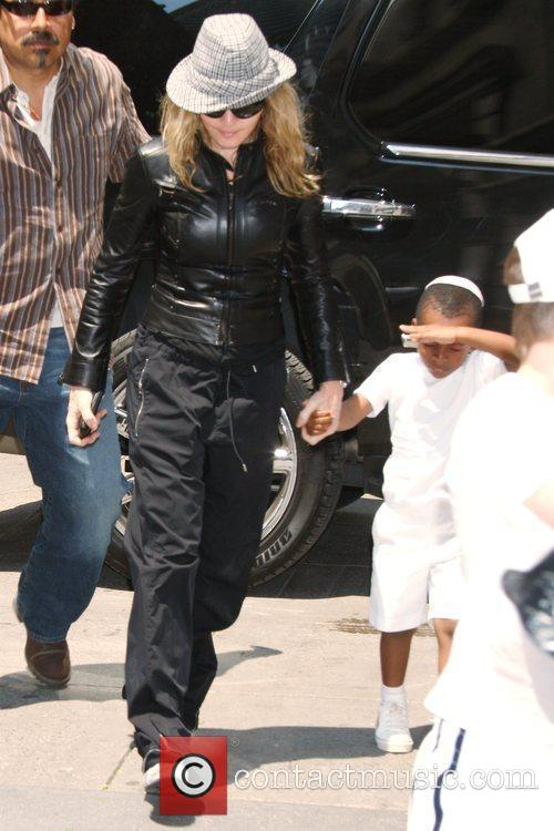 Madonna and Adopted Son David Banda Visit The Kabbalah Center 3