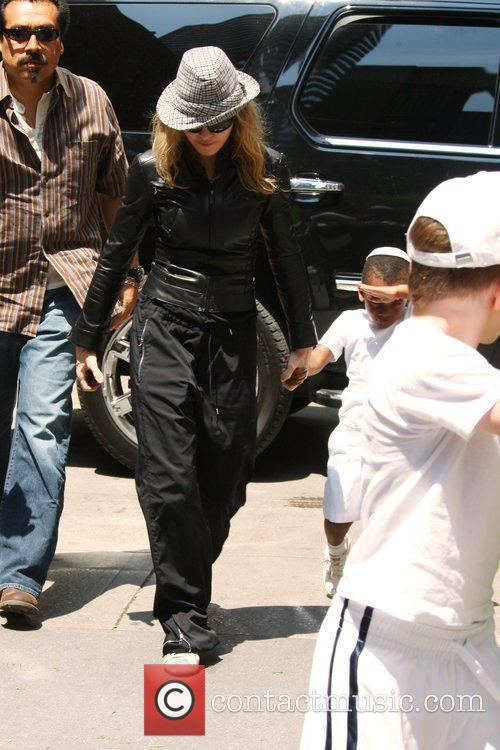 Madonna and Adopted Son David Banda Visit The Kabbalah Center 1