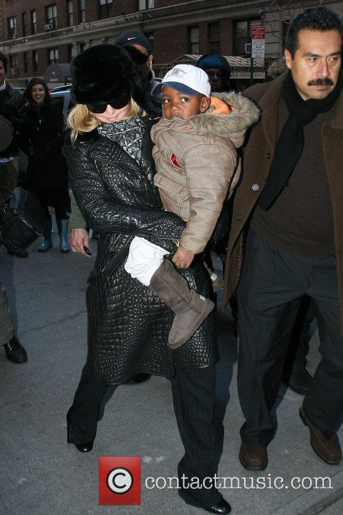 Madonna and David Banda outside the Manhattan Kabbalah...