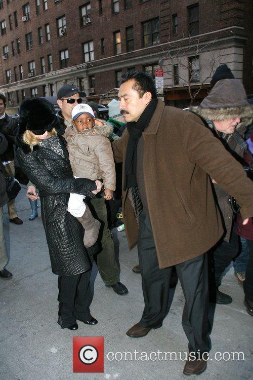 Madonna and David Banda outside the Manhattan Kabbalah...