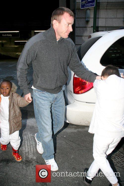 Guy Ritchie picking up his sons from the...