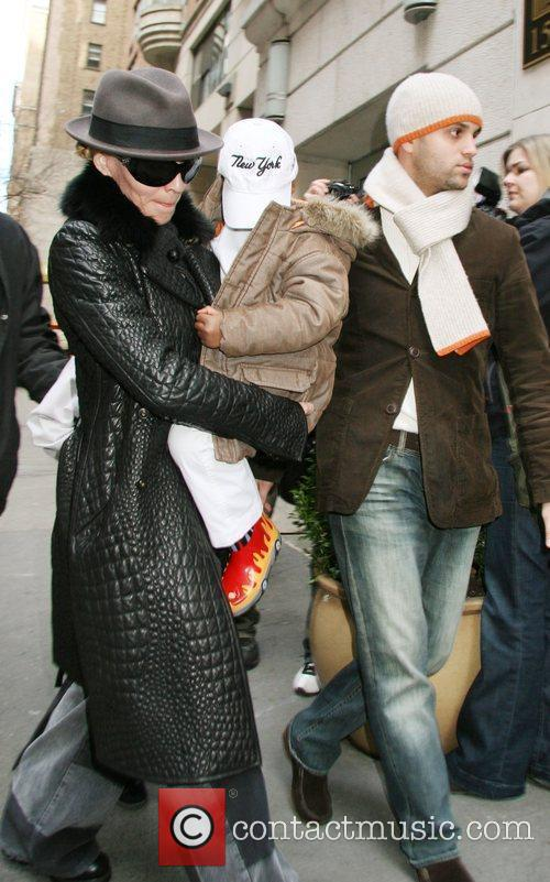 Madonna, David Banda and Bodyguard. arrive at the...