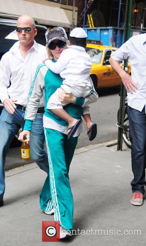 Madonna and son David Banda arrive at the...