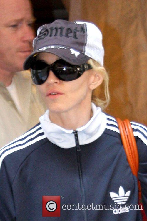 Madonna  leaving the Kabbalah centre with her...