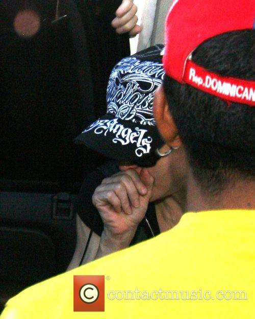 Madonna  and her family leaving the Kabbalah...