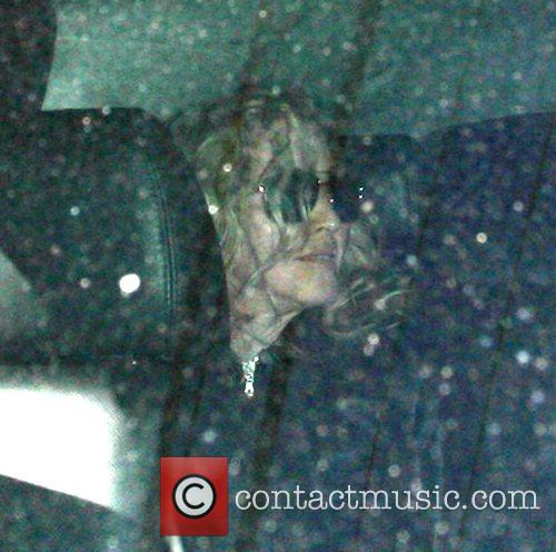 Madonna leaving a Kabbalah centre with her daughter...