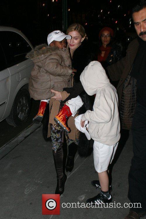 Madonna, David Banda and Rocco Ritchie Madonna arrives...