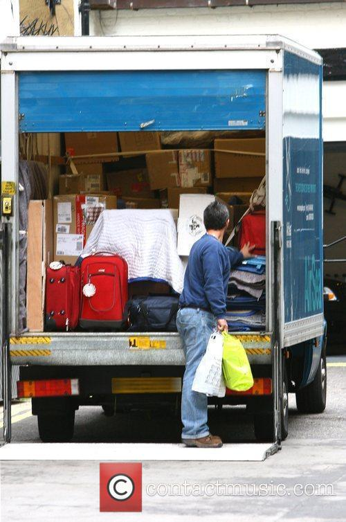 An AirSea packing removal van appears outside Madonna's...