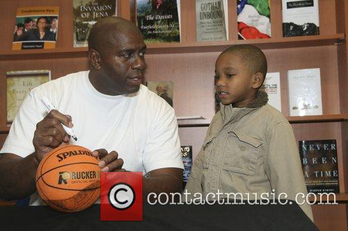 Earvin MagicJohnson Signs copies of his book '32...